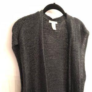 Long sleeveless sweater